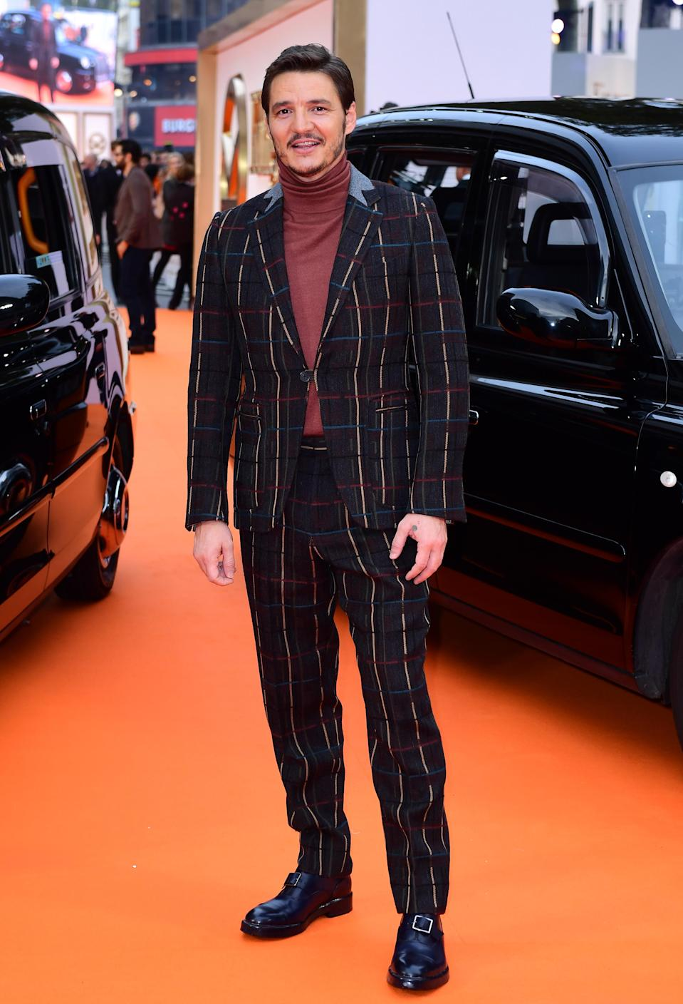 <p>Everyone's favourite 'Game of Thrones' cast member was the most stylish man of the night in a turtleneck and colourful stripy suit.<br><i>[Photo: PA]</i> </p>
