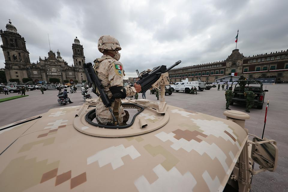 VARIOUS CITIES, MEXICO - SEPTEMBER 16: Mexican soilders pose during the Independence Day military parade at Zocalo Square on September 16, 2020 in Various Cities, Mexico. This year El Zocalo remains closed for general public due to coronavirus restrictions. Every September 16 Mexico celebrates the beginning of the revolution uprising of 1810. (Photo by Hector Vivas/Getty Images)