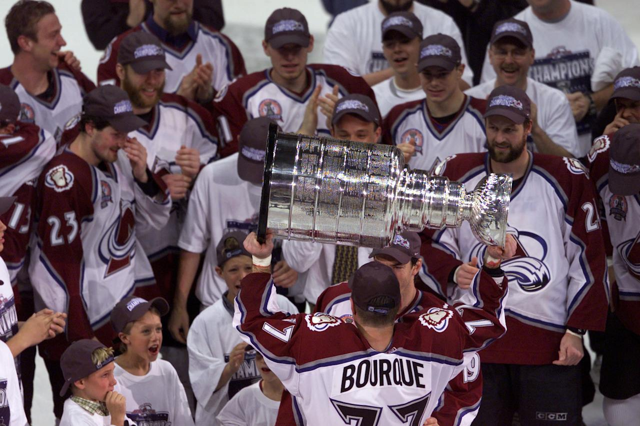 9 Jun 2001: Ray Bourque #77 of the Colorado Avalanche hoists the Stanley Cup after defeating the New Jersey Devils during the Stanley Cup finals at the Pepsi Center in Denver, Colorado. The Avalanche defeated the Devils 3-1 to win the series 4-3. DIGITAL IMAGE Mandatory Credit: Brian Bahr/ALLSPORT
