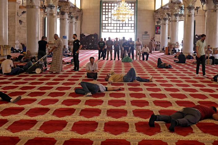 Palestinian worshippers rested at Al-Aqsa mosque on May 10, 2021.