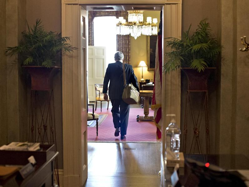 """Senate Minority Leader Mitch McConnell of Kentucky, arrives at his office in the Capitol as he and Senate Majority Leader Harry Reid of Neveda try to negotiate a legislative solution to avoid the so-called """"fiscal cliff,"""" in Washington, Sunday, Dec. 30, 2012. (AP Photo/J. Scott Applewhite)"""
