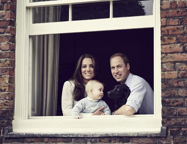 <p>An unexpected photo of Prince George with his pet dog and parents was released to mark Mother's Day in March 2014, ahead of the family's tour of Australia and New Zealand. (Photo: Getty Images) </p>