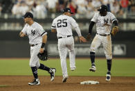 From left, New York Yankees' DJ LeMahieu, Gleyber Torres and Didi Gregorius celebrate after defeating the Boston Red Sox in a baseball game, Saturday, June 29, 2019, in London. Major League Baseball made its European debut game Saturday at London Stadium. (AP Photo/Tim Ireland)