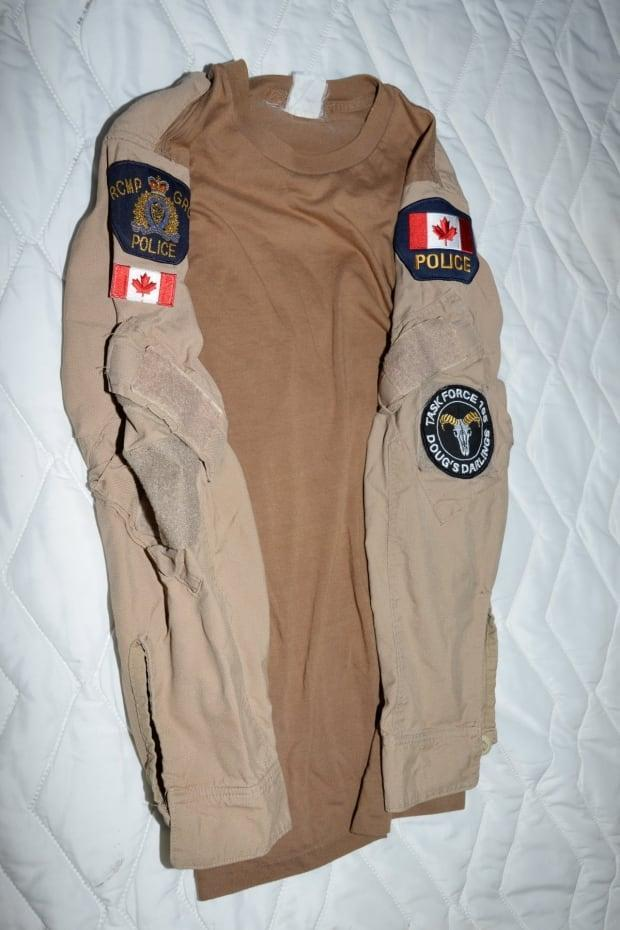 RCMP also seized an article of clothing found in a search, which they say was modified to look like a uniform.