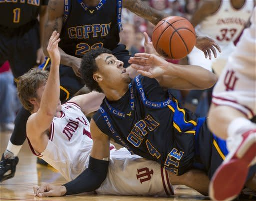 Coppin State's Zach Burnham and Indiana's Jordan Hulls, left, fall to the floor while scrambling for a loose ball in the first half of an NCAA college basketball game Saturday, Dec. 1, 2012, in Bloomington, Ind. (AP Photo/Doug McSchooler)