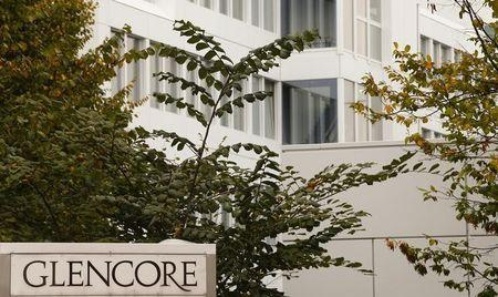 The logo of commodities trader Glencore is pictured in front of the company's headquarters in Baar