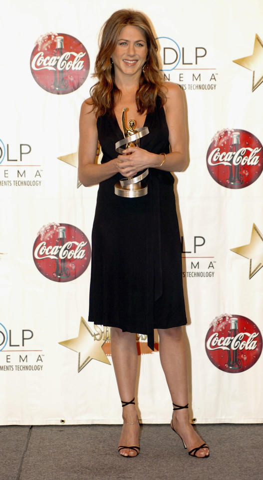 <p>In one of her first public appearances after announcing her divorce from Brad Pitt, Aniston wore a classic LBD and wavy locks to receive the award for Female of the Year at ShoWest conference in 2005. </p>