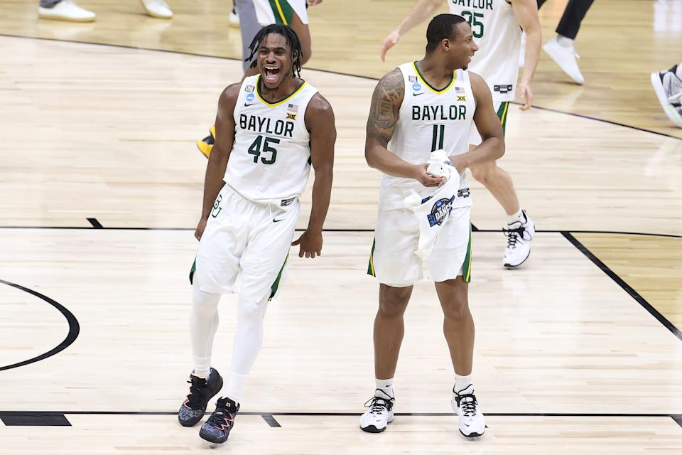 Davion Mitchell (L) and Mark Vital celebrate after defeating Arkansas in the Elite Eight on March 29. (Andy Lyons/Getty Images)