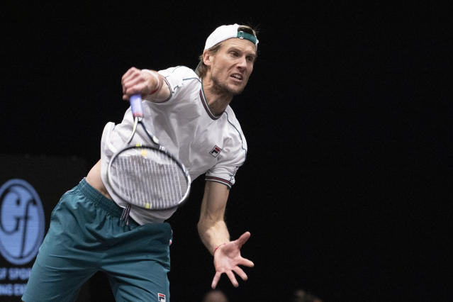 Andreas Seppi, of Italy, serves to Kyle Edmund, of Britain, in the final of the New York Open tennis tournament Sunday, Feb. 16, 2020 in Uniondale, N.Y. (AP Photo/Mark Lennihan)