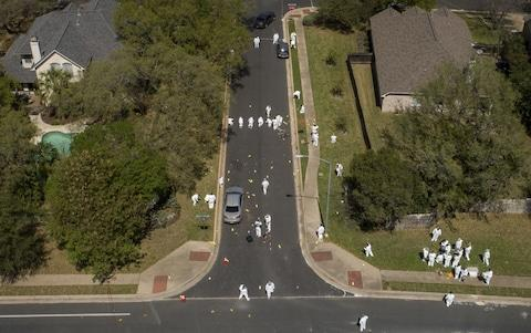 "A 24-year-old man suspected of a series of deadly bombings that have terrorised the Texan capital of Austin for almost a month has blown himself up as police closed in on him, as the FBI warned that other parcel bombs might have been planted. The suspect killed himself in his car at the side of a road as authorities moved in to arrest him early on Wednesday, officials said. Austin Police Chief Brian Manley identified the suspect as a 24-year-old white man. He said a motive for the bombings is not yet known and it is unclear if the man was acting alone or with accomplices. Mr Manley said the suspect is believed to be responsible for all five bomb explosions that have killed two and wounded several more and put people on edge in the Texan capital since March 2. But FBI agent Chris Combs, head of the agency's San Antonio office, said: ""We are concerned that there may be other packages that are still out there."" Police had closed in on the subject in the Austin suburb of Round Rock early on Wednesday Credit: Eric Gay /AP After the suspects death was confirmed, US President Donald Trump tweeted that it had been a ""great job by law enforcement and all concerned!"". AUSTIN BOMBING SUSPECT IS DEAD. Great job by law enforcement and all concerned!— Donald J. Trump (@realDonaldTrump) March 21, 2018 ""The suspect is deceased,"" Austin police chief Brian Manley told a news conference as he said the man's name will not be released until his next of kin are notified. Police had traced the suspect's car to a hotel in the Austin suburb of Round Rock. As authorities waited for tactical teams to arrive, the man started to drive away. When officers moved to stop and arrest him, the man detonated a bomb inside his car and was killed, Mr Manley said. One police officer was injured by the blast. Austin Police Chief Brian Manley, right, delivers a media briefing on Wednesday morning Credit: Eric Gay /AP Mr Manley warned that it was not clear whether or not any more bombs had been left in place around the city. Police had urged residents to treat packages with suspicion during the bombing campaign and Manley warned residents not to let their guard down yet. ""Everybody needs to remember that this investigation is continuing. We still need people to be vigilant,"" Austin Mayor Steve Adler said. ""We don't know where the suspect has been the last 24 hours."" Investigators work at the scene of a bombing in Austin on Monday Credit: Jay Janner/REX/Shutterstock Police had closed in on the suspect over the past 36 hours as evidence came in from video footage and witness accounts. ""It has been a long almost three weeks for the community of Austin,"" the police chief said. A local TV station in San Antonio had published what it said were photos of the suspect, wearing a blue baseball cap, gloves and possibly a wig as he dropped off packages Sunday at a FedEx office. The photos came from security video at that office. BREAKING: Exclusive photos of Austin bombing 'Person of Interest' dropping off 2 packages at Austin @FedEx store. Believed to be wearing wig. Recognize him? Contact: @FBI@Austin_Police More info: https://t.co/8bVRGToc7T@News4SA@cbsaustinpic.twitter.com/mpTxxrkYfd— Randy Beamer (@randybeamer) March 21, 2018 One of the Austin bombs went off early Tuesday at a FedEx sorting facility. Two people were killed and more injured by four package bombings in Austin that began on March 2. The bombings began with parcels left on doorsteps, then continued with a bomb apparently set off by a tripwire on Sunday and two packages that detonated at FedEx Corp facilities on Tuesday. Austin serial bombings timeline Austin bombs had grown in sophistication As the investigation proceeded, police said the bombs were growing in sophistication. The first three were hand-delivered to the doorsteps of people's houses. The fourth featured a trip wire and the fifth was sent into the FedEx delivery chain. Texas troopers halt near the site of an explosion in Austin Credit: Anadolu Agency/Getty More than 1,200 calls came in from residents since police urged them to report suspicious activities after the first explosion. In the end, police were offering a reward of $115,000 (£81,000) for information leading to an arrest. 'No clear idea' of bomber's motive Mr Manley said investigators still had no clear idea of what prompted the suspect to carry out the bombing. ""We do not understand what motivated him to do what he did,"" Manley said. ""We don't know if he was on his way to deliver another bomb,"" Manley said. ""He had one with him and that's what he detonated as we approached."""