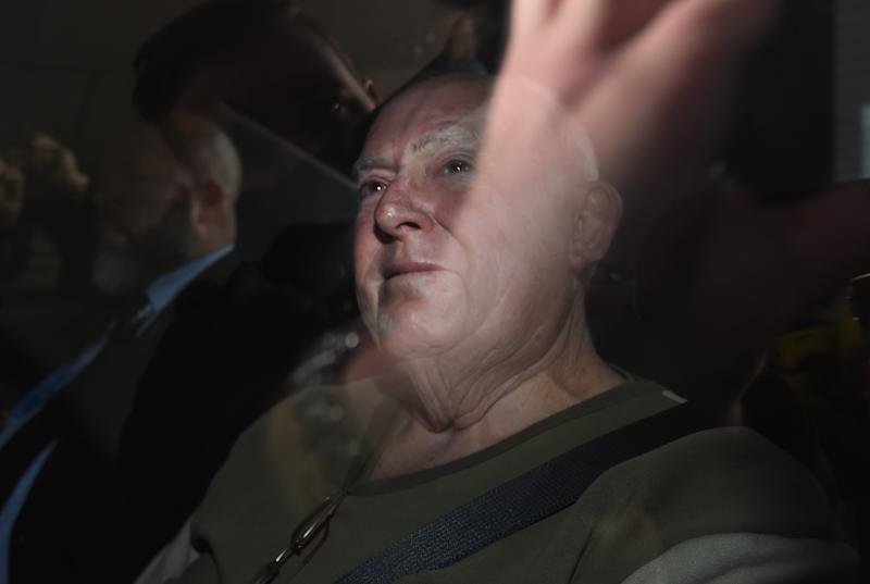 John Chardon is brought into the police watch-house Brisbane, Friday, June 17, 2016. Chardon was arrested and is expected to be charged in relation to the alleged murder of his wife Novy Chardon, who has been missing since 2013. (AAP Image/Dan Peled)
