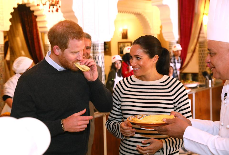 The Duke and Duchess of Sussex try some food during a cooking school demonstration at Villa des Ambassadors in Rabat on the third day of their tour of Morocco.