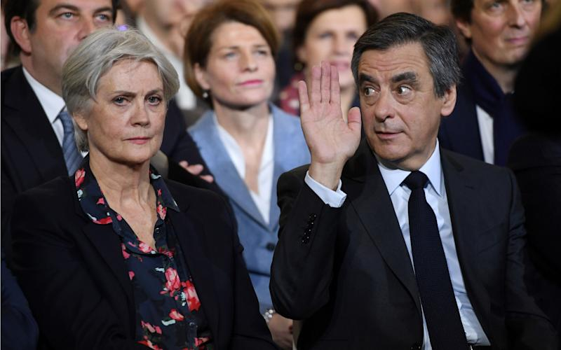 Francois Fillon (R), flanked by his wife Penelope Fillon - AFP or licensors