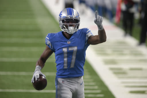 Detroit Lions wide receiver Marvin Hall runs into the end zone after a 55-yard reception for a touchdown during the first half of an NFL football game against the Washington Football Team, Sunday, Nov. 15, 2020, in Detroit. (AP Photo/Tony Ding)
