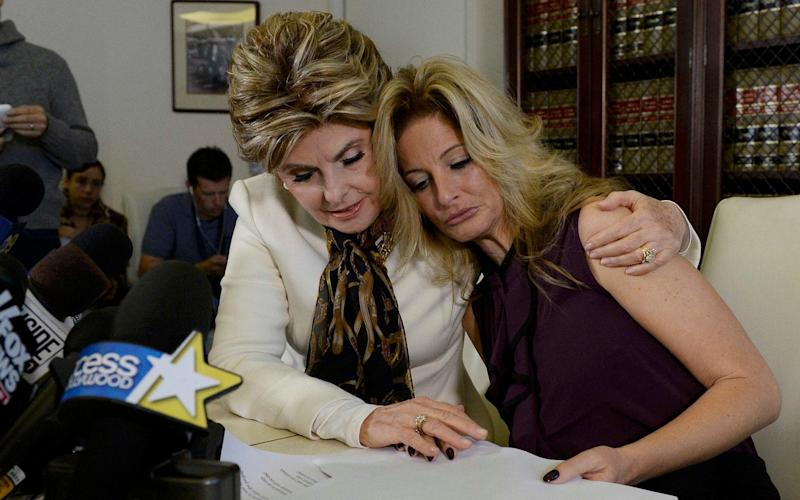 Summer Zervos, right, with her lawyer Gloria Allred, makes the accusations against Donald Trump at a news conference in October - KEVORK DJANSEZIAN/AP