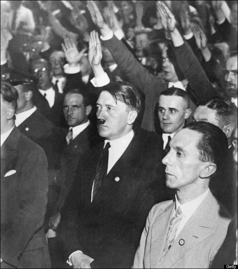 BERLIN, GERMANY: Undated and unlocated picture of Nazi leader Adolf Hitler (C,1889-1945) with Joseph Goebbels (R), Hitler's enthusiastic supporter. After Hitler was made Chancellor in January 1933, he appointed Goebbels head of the Ministry of Public Enlightenment and Propaganda. Hitler then suspended the constitution, silenced opposition, exploited successfully the burning of the Reichstag (Parliament) building, and brought the Nazi Party to power. (Photo credit should read AFP/Getty Images)