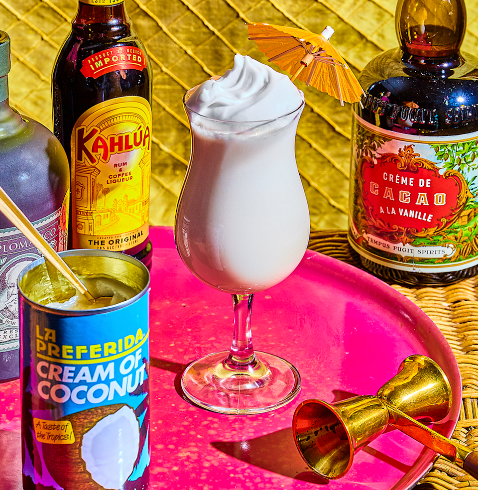 """<p><em>It's basically a milkshake. An alcoholic milkshake.</em></p><p><strong>Ingredients</strong></p><p>• 2 oz. dark rum<br>• 1 oz. Kahlúa<br>• 1 oz. dark crème de cacao<br>• 2 oz. cream of coconut<br>• 2 oz. milk<br>• nutmeg, whipped cream, or cherry (optional) </p><p><strong>Directions</strong></p><p>Blend ingredients with ice—start with 1/2 c. and add from there—until the mix reaches milkshake consistency. Pour into a hurricane-style glass, then garnish with grated nutmeg, whipped cream, or a maraschino cherry.</p><p><a class=""""link rapid-noclick-resp"""" href=""""https://www.esquire.com/food-drink/drinks/a31250466/bushwacker-drink-milkshake-recipe/"""" rel=""""nofollow noopener"""" target=""""_blank"""" data-ylk=""""slk:Read More"""">Read More</a></p>"""