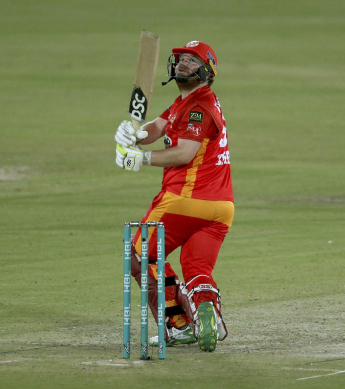 Islamabad United' Paul Stirling follows the ball after playing a shot for six during a Pakistan Super League T20 cricket match between Islamabad United and Quetta Gladiators at the National Stadium, in Karachi, Pakistan, Tuesday, March 2, 2021. (AP Photo/Fareed Khan)