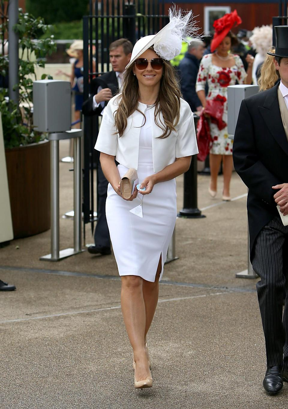 <p>Liz went for a simple white shift dress last year.<br><i>[Photo: PA]</i> </p>