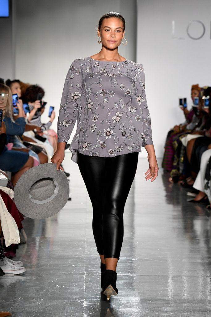 <p>Curvy model Marquita Pring, who is signed by IMG Models, walks Loft's show wearing a floral blouse and faux leather leggings at theCURVYcon during New York Fashion Week. (Photo: Getty Images) </p>