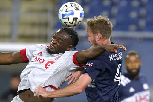 Toronto FC's Ayo Akinola, left, vies for control of the ball with New England Revolution's Henry Kessler during the second half of an MLS soccer match, Wednesday, Oct. 7, 2020, in Foxborough, Mass. Akinola scored in the first half to help Toronto FC win 1-0. (AP Photo/Steven Senne)