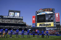 A memorial to baseball great Tom Seaver is held before a baseball game between the New York Mets and the Miami Marlins Thursday, April 8, 2021, in New York. (AP Photo/John Minchillo)