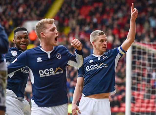 "Soccer Football - Championship - Sheffield United vs Millwall - Bramall Lane, Sheffield, Britain - April 14, 2018 Millwall's Steve Morison celebrates scoring their first goal with George Saville and team mates Action Images/Paul Burrows EDITORIAL USE ONLY. No use with unauthorized audio, video, data, fixture lists, club/league logos or ""live"" services. Online in-match use limited to 75 images, no video emulation. No use in betting, games or single club/league/player publications. Please contact your account representative for further details."