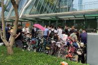People protest to demand repayment of loans and financial products at the Evergrande's headquarters in Shenzhen