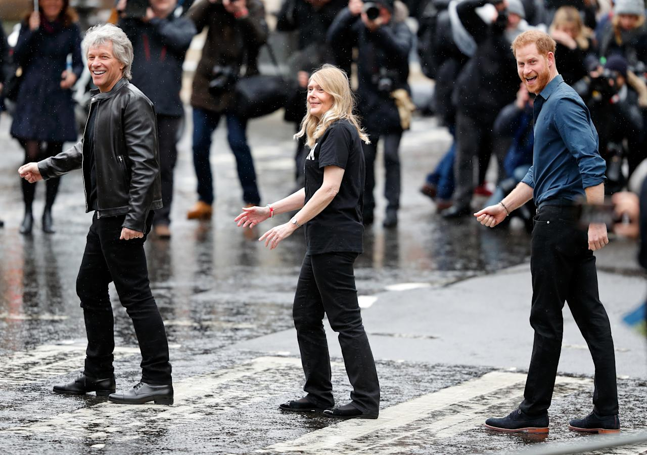 LONDON, UNITED KINGDOM - FEBRUARY 28: (EMBARGOED FOR PUBLICATION IN UK NEWSPAPERS UNTIL 24 HOURS AFTER CREATE DATE AND TIME) Jon Bon Jovi (L) and Prince Harry, Duke of Sussex (R) along with members of the Invictus Games Choir recreate the iconic Beatles Abbey Road album cover photograph on the zebra crossing outside the Abbey Road Studios where the Invictus Games Choir are recording a special single in aid of the Invictus Games Foundation on February 28, 2020 in London, England. (Photo by Max Mumby/Indigo/Getty Images)