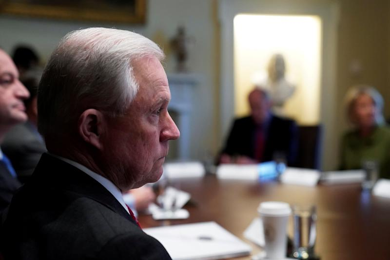 U.S. Attorney General Jeff Sessions listens as U.S. President Donald Trump holds a cabinet meeting at the White House in Washington, U.S., January 10, 2018.  REUTERS/Jonathan Ernst