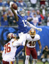 FILE - In this Oct. 28, 2018, file photo, New York Giants wide receiver Odell Beckham Jr. (13) makes a one handed catch against Washington Redskins safety D.J. Swearinger (36) and linebacker Josh Harvey-Clemons (40) during an NFL football game, in East Rutherford, N.J. No longer a punching bag, the Browns are punching back. From hopeless to hopeful. Finally. In landing Beckham, one of the games most electrifying players, the Browns have risen from the deepest depths imaginable in just a year. (AP Photo/Brad Penner, File)