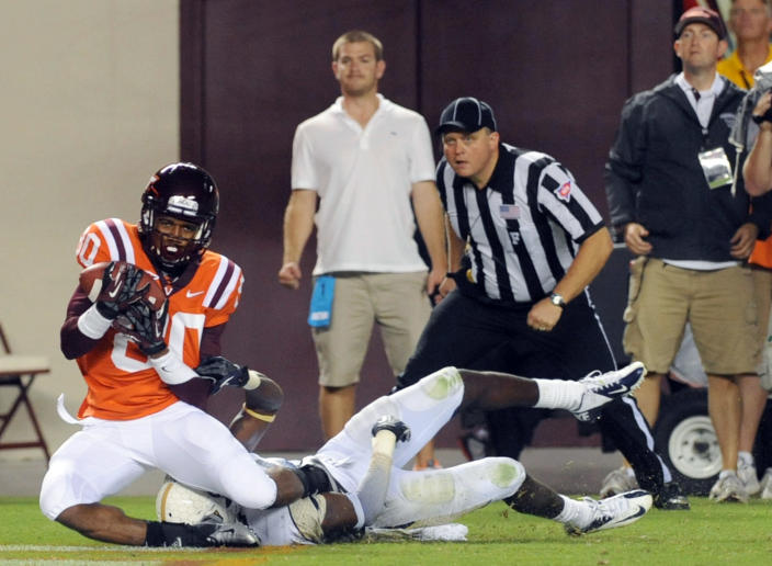 Virginia Tech wide receiver Demitri Knowles (80) hangs on to a pass in the end zone for a touchdown against Georgia Tech cornerback Rod Sweeting during the second half of an NCAA college football game, Monday, Sept. 3, 2012, in Blacksburg, Va. Virginia Tech won 20-17 in overtime. (AP Photo/Don Petersen)