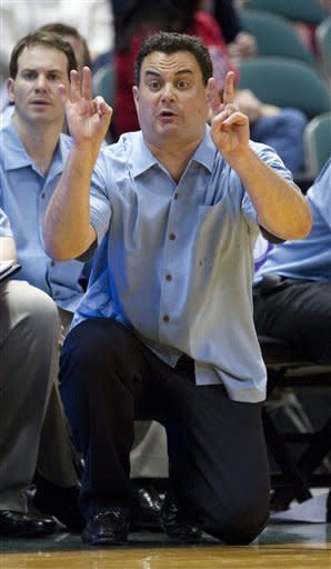 Arizona head coach Sean Miller signals a play for his team in the first half of an NCAA college basketball game in the Diamond Head Classic Sunday, Dec. 23, 2012, in Honolulu. (AP Photo/Eugene Tanner)