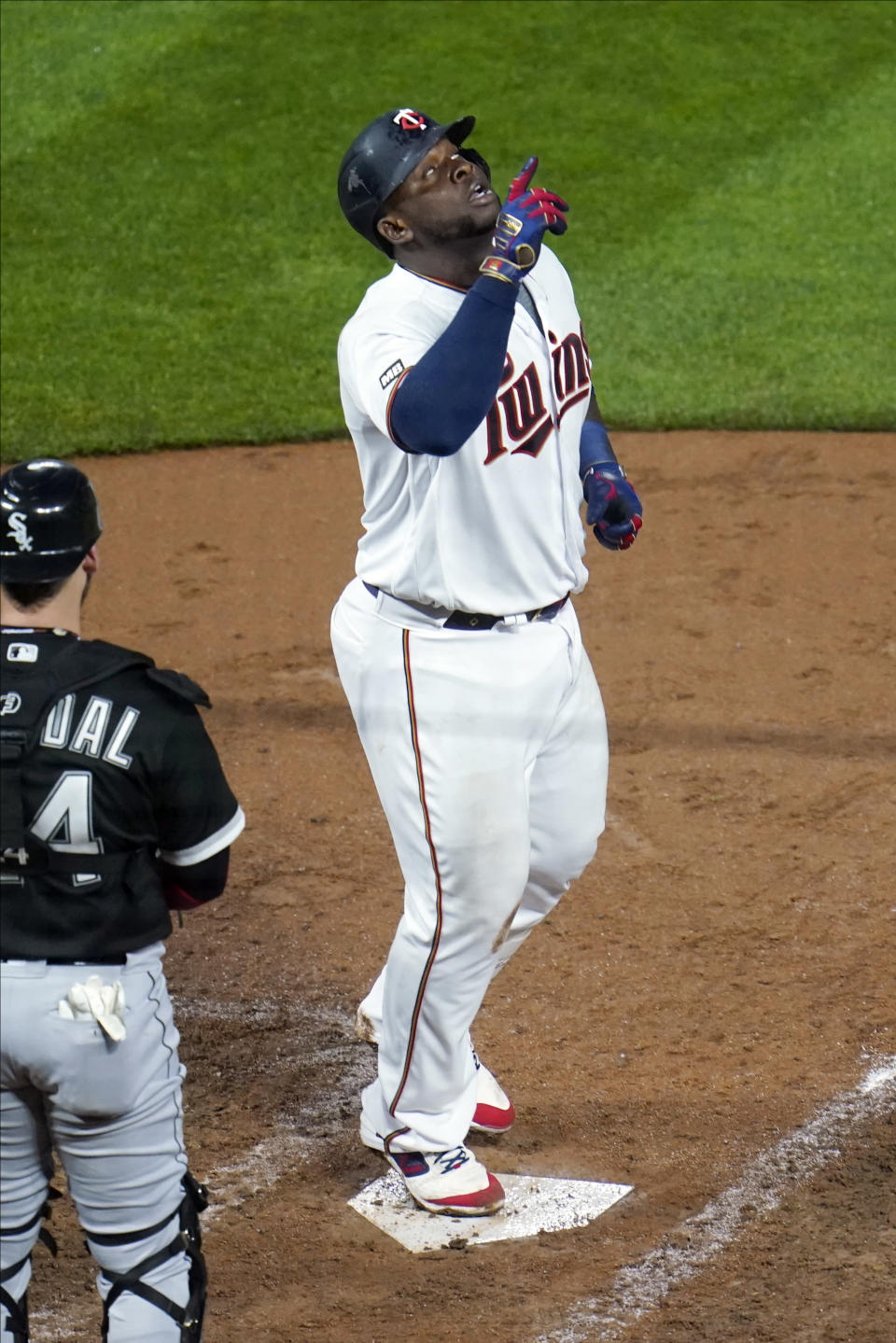 Minnesota Twins' Miguel Sano celebrates his second home run of the night off Chicago White Sox pitcher Lance Lynn, during the sixth inning of a baseball game Tuesday, May 18, 2021, in Minneapolis. (AP Photo/Jim Mone)