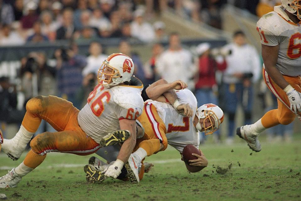 Tampa Bay Buccaneers quarterback Craig Erickson reacts as he heads for the turf while being sacked during a 1993 game. (AP Photo/Doug Pizac)