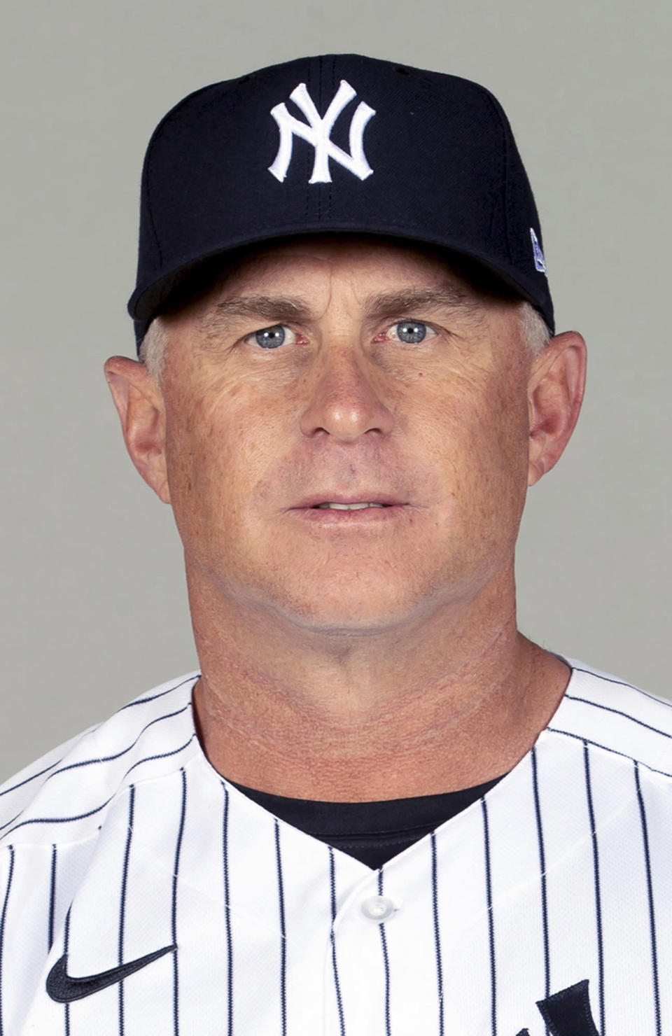This is a 2021 photo of Phil Nevin of the New York Yankees baseball team. The Yankees announced Tuesday, May 11, 2021, that third base coach Phil Nevin, who is fully vaccinated, has tested positive for the coronavirus. Nevin is currently under quarantine protocol in Tampa. Under Major League Baseball's guidance and advice, and with its assistance, additional testing and contact tracing are ongoing. (Mike Carlson/MLB Photos via AP, File)
