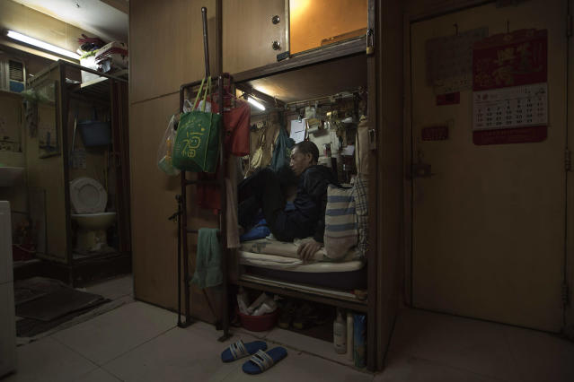 "<p>Wong Tat-ming, 63, sits in his ""coffin home"" In Hong Kong. (Photo: Kin Cheung/AP) </p>"