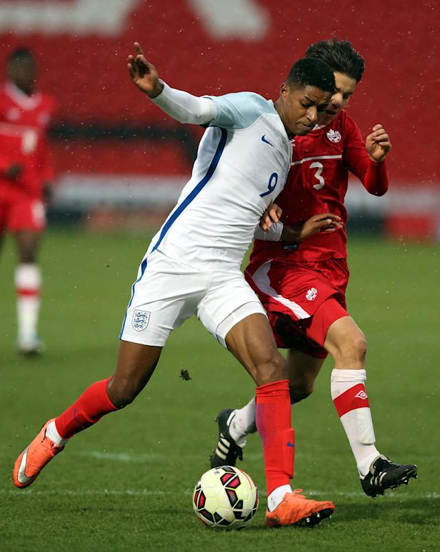 DONCASTER, ENGLAND - MARCH 27: Marcus Rashford of England (L) challenged by Kadin Chung of Canada during the U20 International Friendly match between England and Canada at the Keepmoat Stadium on March 27, 2016 in Doncaster, England. (Photo by Nigel Roddis/Getty Images)