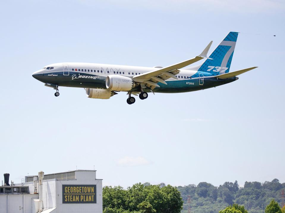 <p>A Boeing 737 MAX jet lands following an FAA test flight </p> (AFP via Getty Images)