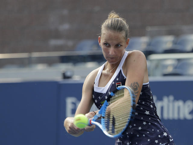 Kristyna Pliskova, of the Czech Republic, returns a shot to Zarina Diyas, of Kazakhstan, during the first round of the U.S. Open tennis tournament, Monday, Aug. 27, 2018, in New York. (AP Photo/Jason DeCrow)