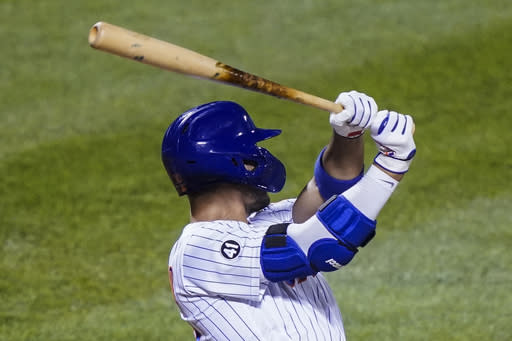 New York Mets Michael Conforto, wearing a No. 41 patch in honor of the late Tom Seaver, follows through a two-run home run off Philadelphia Phillies starting pitcher Jake Arrieta during the fifth inning of a baseball game Friday, Sept. 4, 2020, in New York. (AP Photo/John Minchillo)