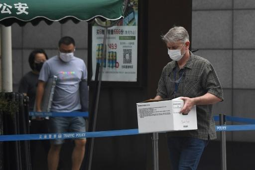 Staff at the US consulate in Chengdu were busy packing as they prepared for a hasty exit