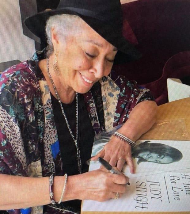 Judi Singh, who now lives in Victoria, B.C., signs a copy of her album, A Time For Love.