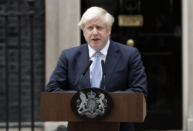 Britain's Prime Minister Boris Johnson speaks to the media outside 10 Downing Street (AP Photo/Matt Dunham)
