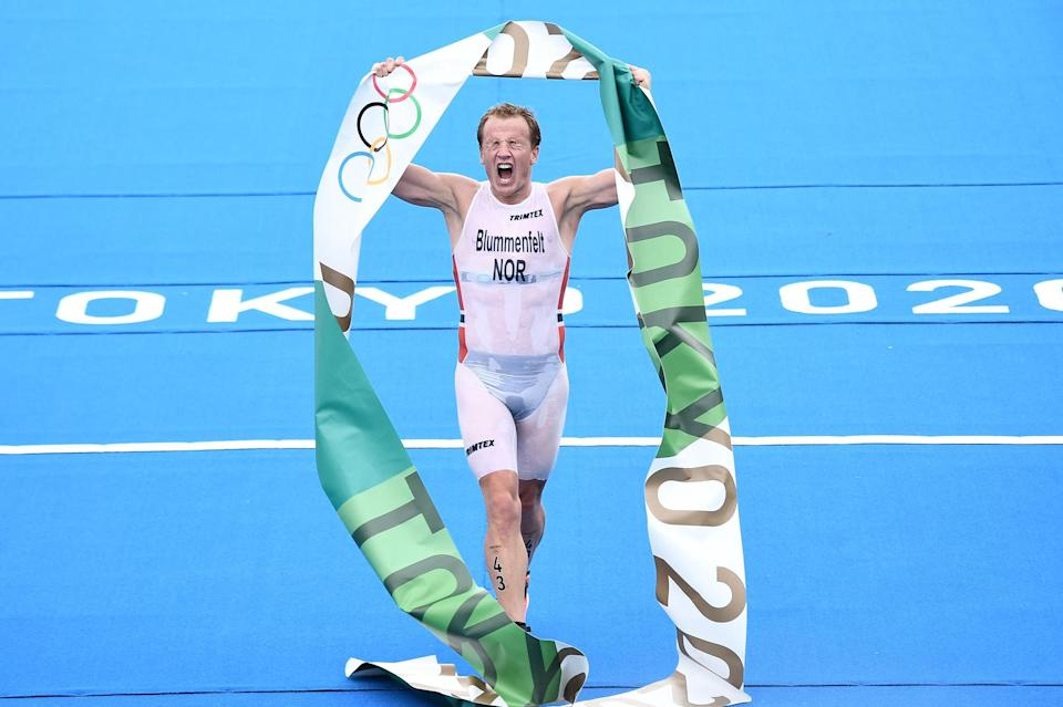 <p>Norway's Kristian Blummenfelt triumphantly holds up the Olympics banner following his men's individual triathlon competition win at the Odaiba Marine Park on July 26.</p>