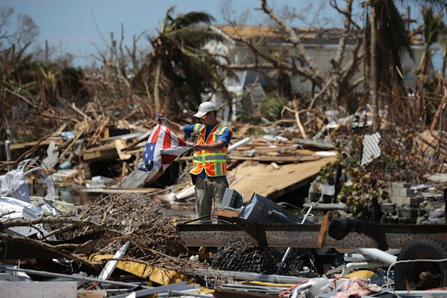 Rescue volunteer Sam Kichline from What's Next Adventures searches for people in a waterfront neighborhood hard hit by Hurricane Irma on Sept. 15 in Marathon, Florida. (Chip Somodevilla via Getty Images)