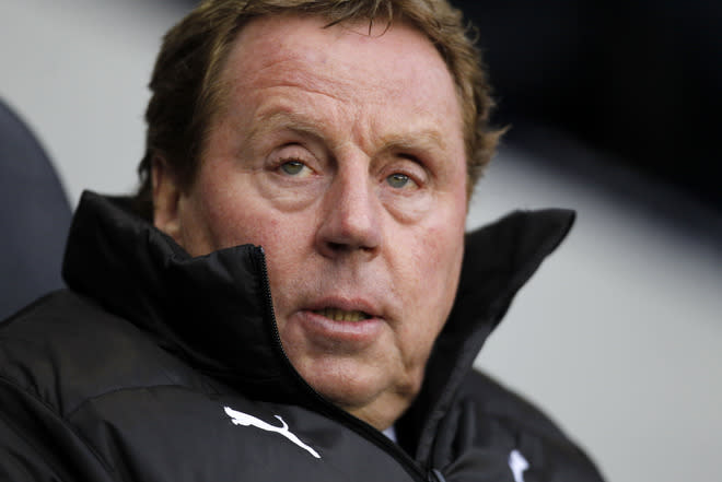 """(FILES) In a file picture taken on January 7, 2012 Tottenham Hotspur's English manager Harry Redknapp looks on before the English FA Cup third round football match between Tottenham Hotspur and Cheltenham Town at White Hart Lane in north London.  Redknapp said on February 10, 2012 he was """"flattered"""" to be the odds-on favourite to replace Fabio Capello as England manager but was cautious about combining the job with his club role. AFP PHOTO / IAN KINGTON  RESTRICTED TO EDITORIAL USE. No use with unauthorized audio, video, data, fixture lists, club/league logos or """"live"""" services. Online in-match use limited to 45 images, no video emulation. No use in betting, games or single club/league/player publications"""