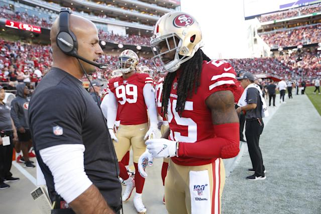 San Francisco defensive coordinator Robert Saleh shares a word with Richard Sherman on Oct. 7, the start of the 49ers' dominant defensive run this month. In three games, the Niners have surrendered only 10 points. (Getty Images)