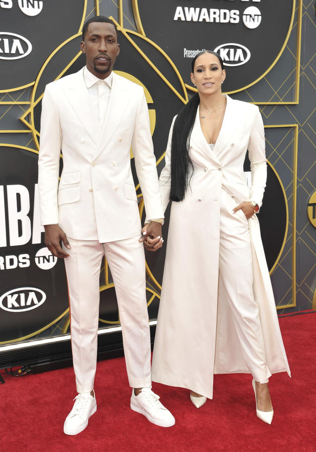 NBA player Kentavious Caldwell-Pope, of the Los Angeles Lakers, left, and McKenzie Caldwell-Pope arrive at the NBA Awards on Monday, June 24, 2019, at the Barker Hangar in Santa Monica, Calif. (Photo by Richard Shotwell/Invision/AP)