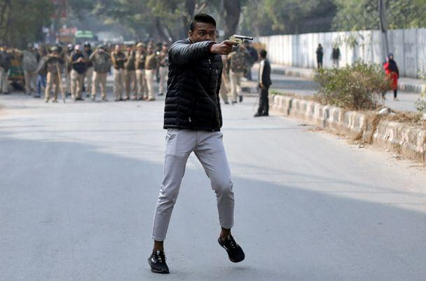 PHOTO: An unidentified man brandishes a gun during a protest against a new citizenship law outside the Jamia Millia Islamia university in New Delhi, Jan. 30, 2020. (Danish Siddiqui/Reuters)